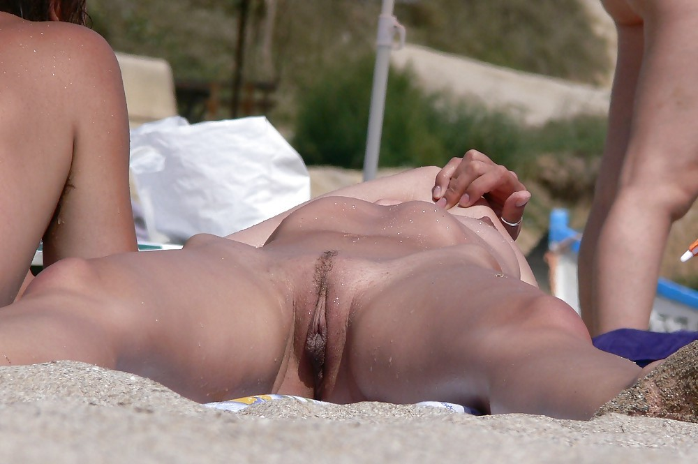 Sleeping women get flash cum on the nude beach #7