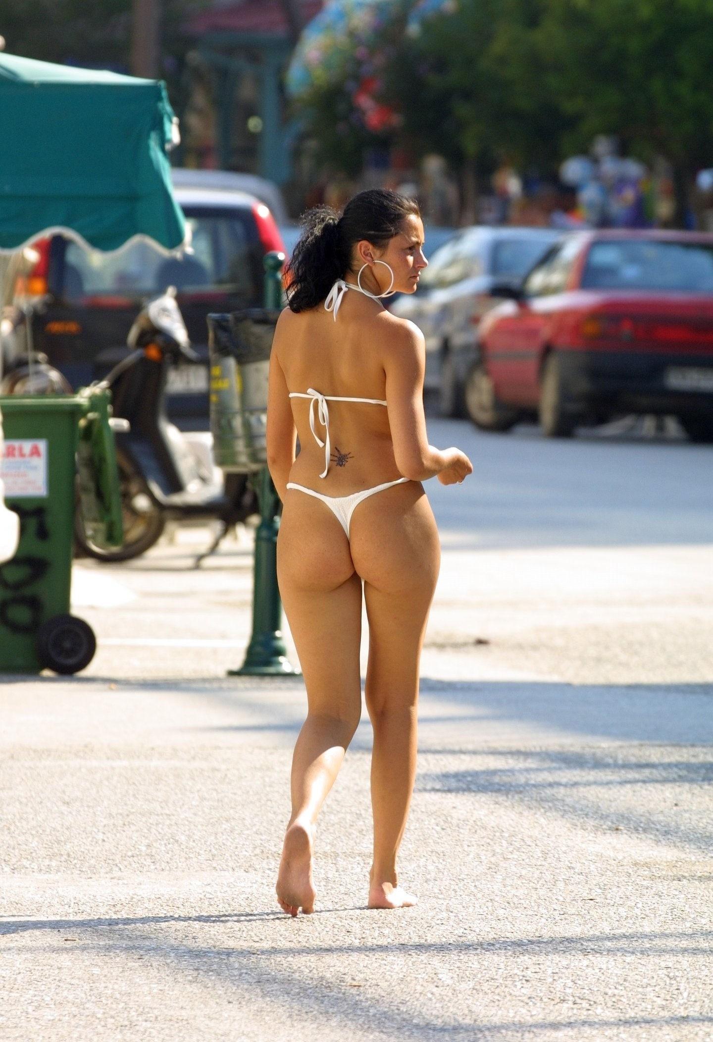 Nude girls holding thongs 4